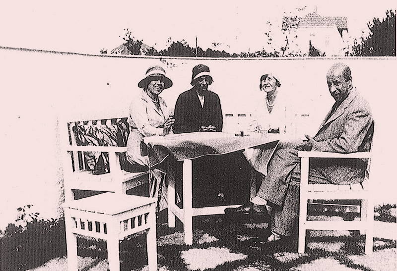 Josef Frank visits Villa Carlsten. Patio furniture by Frank. Original dividing wall in the garden in the background.